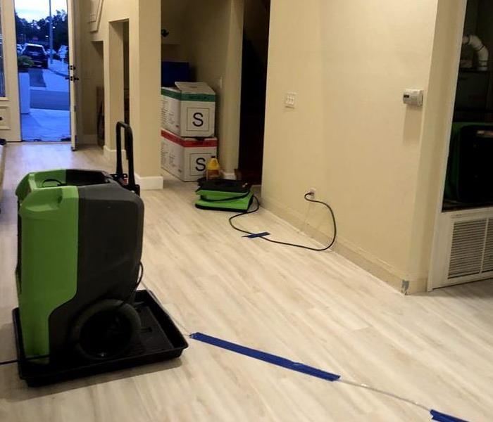 hallway with drying equipment